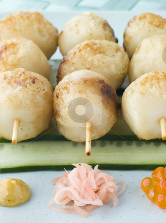 Fish Ball Skewers With Cucumber Salad stock photo, Plate of Fish Ball Skewers With Cucumber Salad and decorative condiments by Monkey Business Images