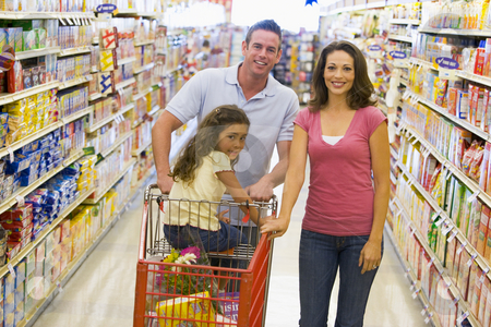 Young family grocery shopping stock photo, Young family grocery shopping in supermarket by Monkey Business Images