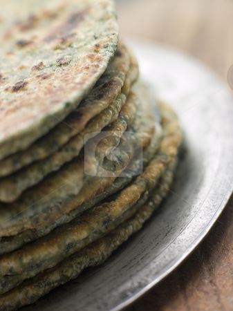 Stack of Sag Roti stock photo, Plate with Stack of Sag Roti by Monkey Business Images