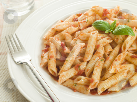 Plate of Penne Arabriatta stock photo,  by Monkey Business Images