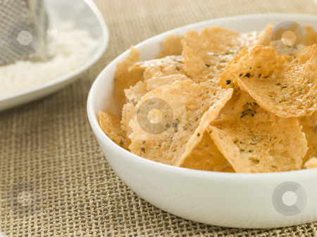 Dish of Parmesan Crisps stock photo,  by Monkey Business Images
