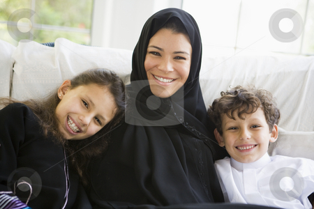 A Middle Eastern woman with her children stock photo,  by Monkey Business Images