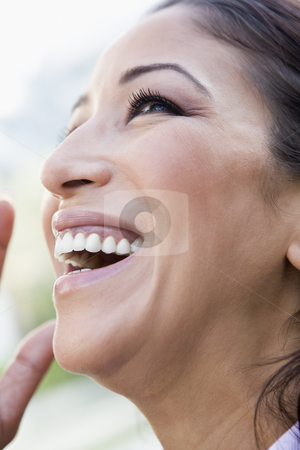 Close-up of woman laughing stock photo, Profile view of woman laughing by Monkey Business Images