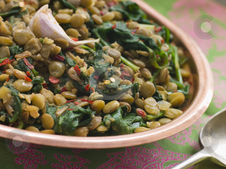 Lentils with spinach and Garlic stock photo, Bowl of Lentils with spinach and Garlic by Monkey Business Images