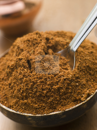 Dish of Tikka Masala Powder stock photo, Close up Dish of Tikka Masala Powder by Monkey Business Images