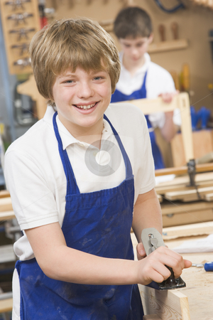 Schoolboy in woodwork class stock photo,  by Monkey Business Images