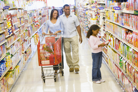Family grocery shopping stock photo, Family grocery shopping in supermarket by Monkey Business Images