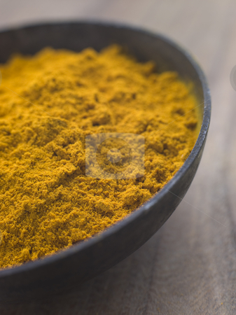 Dish of Ground Dried Turmeric stock photo, Close up Dish of Ground Dried Turmeric by Monkey Business Images