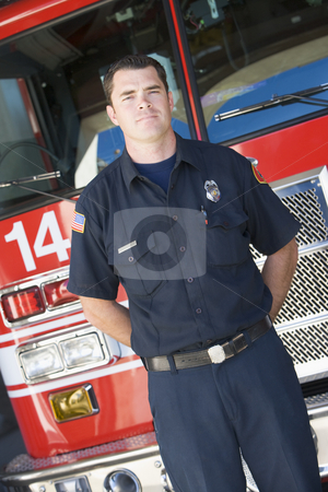 Portrait of a firefighter by a fire engine stock photo,  by Monkey Business Images