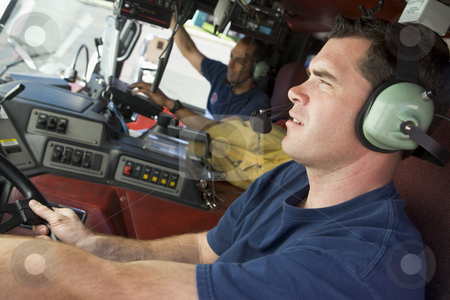 A firefighter driving a fire engine stock photo,  by Monkey Business Images