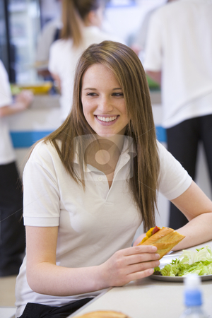 High school students eating in the school cafeteria stock photo,  by Monkey Business Images