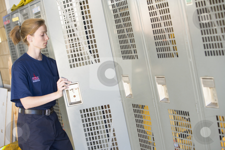 Firefighters in the fire station locker room stock photo,  by Monkey Business Images