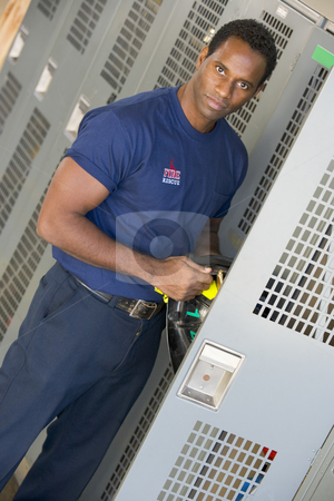 Portrait of a firefighter in the fire station locker room stock photo,  by Monkey Business Images