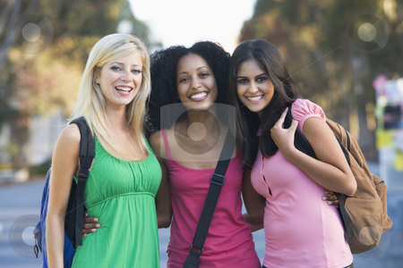 Group of female students having fun stock photo, Group of three female friends having fun off campus by Monkey Business Images