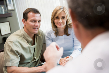 Couple in consultation at IVF clinic stock photo, Couple in consultation at IVF clinic talking to doctor by Monkey Business Images