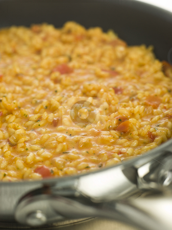 Pan of Milanese Risotto stock photo, Close up of Pan of Milanese Risotto by Monkey Business Images