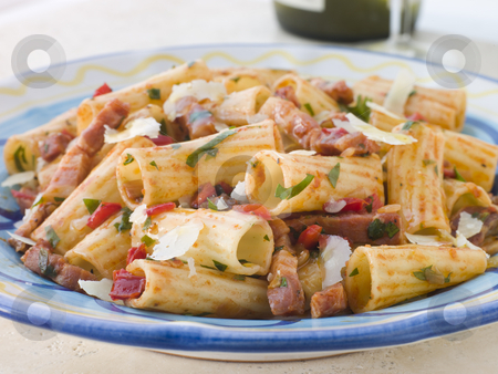 Rigatoni Pasta with a Tomato and Pancetta Sauce stock photo,  by Monkey Business Images