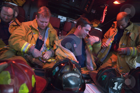 Firefighters preparing for an emergency situation stock photo,  by Monkey Business Images