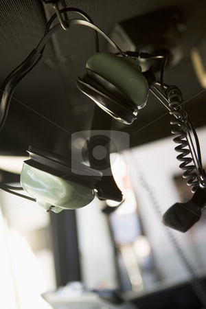 Headphones and microphone hanging inside a fire engine stock photo,  by Monkey Business Images