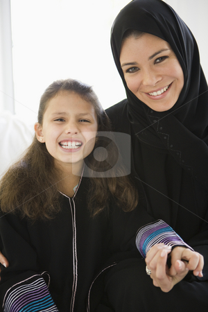 A Middle Eastern woman with her daughter stock photo,  by Monkey Business Images