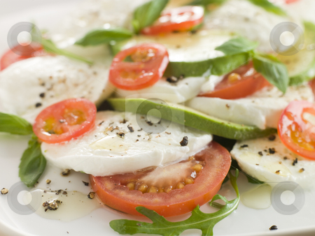 Tomato Avocado and Mozzarella Salad with Olive Oil and Black Pep stock photo,  by Monkey Business Images