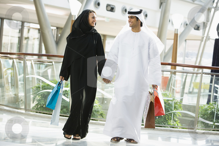 A Middle Eastern couple in a shopping mall stock photo,  by Monkey Business Images