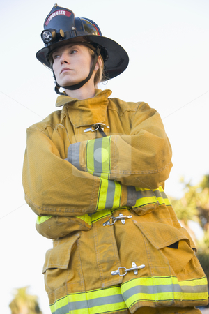 Portrait of a female firefighter stock photo,  by Monkey Business Images