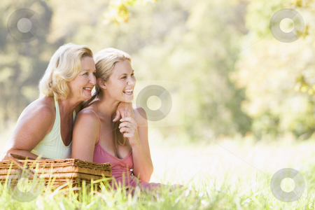 Mother with adult daughter on picnic stock photo,  by Monkey Business Images