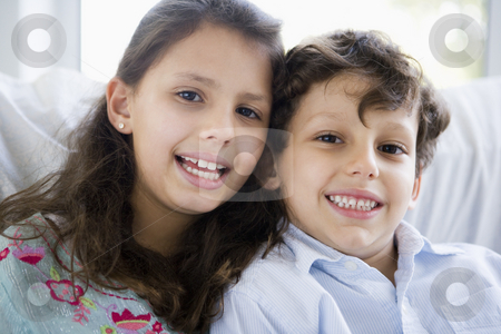 Portrait of two Middle Eastern children at home stock photo,  by Monkey Business Images