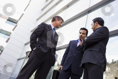 Group of businessmen talking outside office stock photo, Group of businessmen talking outside modern office by Monkey Business Images