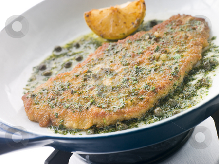 Cotoletta of Veal in a Frying Pan stock photo, Cotoletta of Veal in a Frying Pan with lemon wedge by Monkey Business Images