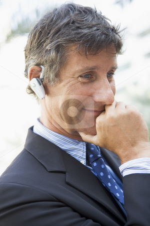 Businessman wearing headset outdoors stock photo,  by Monkey Business Images