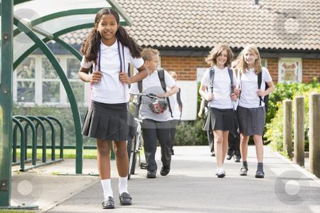Junior school children leaving school stock photo,  by Monkey Business Images
