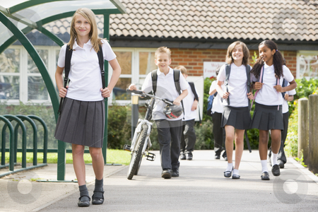 Junior school children leaving school stock photo,  by Monkey Business Images