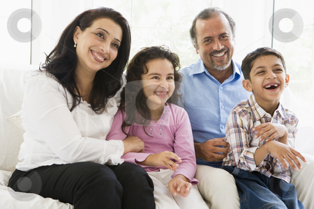A Middle Eastern couple with their grandchildren stock photo,  by Monkey Business Images