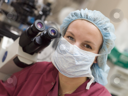 Portrait of embryologist wearing mask stock photo, Portrait of embryologist wearing mask in laboratory by Monkey Business Images