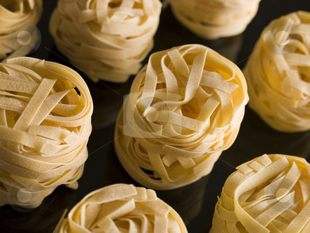 Dried Tagliatelle Nests stock photo, Close up of Dried Tagliatelle Nests by Monkey Business Images