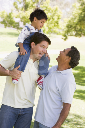 Grandfather with adult son and grandchild stock photo,  by Monkey Business Images