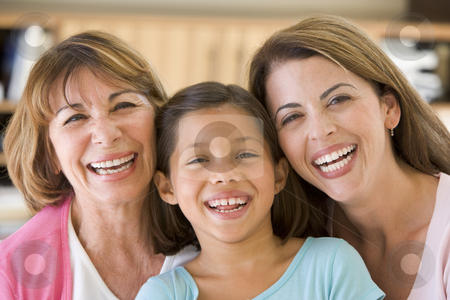 Grandmother with adult daughter and granddaughter stock photo,  by Monkey Business Images