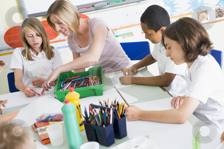 Schoolchildren and their teacher in an art class stock photo,  by Monkey Business Images