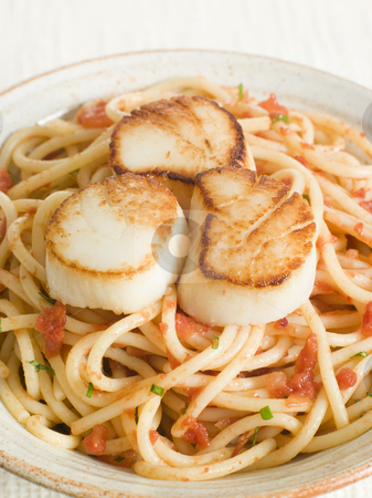Seared Scallops with Chilli and Tomato Spaghetti stock photo,  by Monkey Business Images