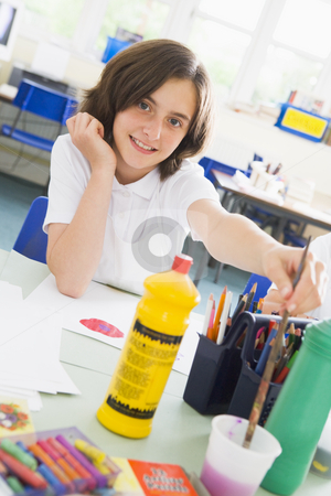A schoolgirl in an art class stock photo,  by Monkey Business Images