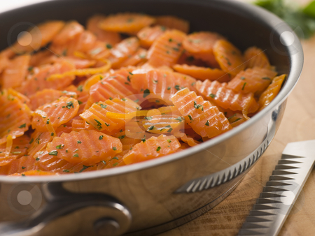 Vichy Carrots in a Saute Pan stock photo,  by Monkey Business Images