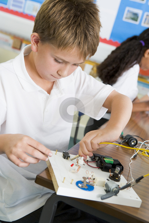 A schoolboy in a science class stock photo,  by Monkey Business Images