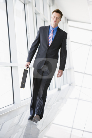 Businessman walking in corridor stock photo,  by Monkey Business Images