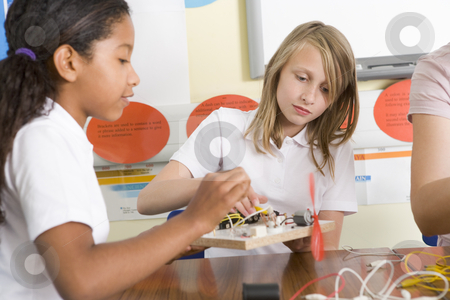 Schoolgirls in a science class stock photo,  by Monkey Business Images