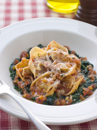 Vegetable Tortellini with Spinach and Tomato Salsa stock photo,  by Monkey Business Images