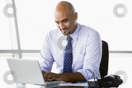Businessman working at laptop stock photo, Businessman working at laptop in office by Monkey Business Images