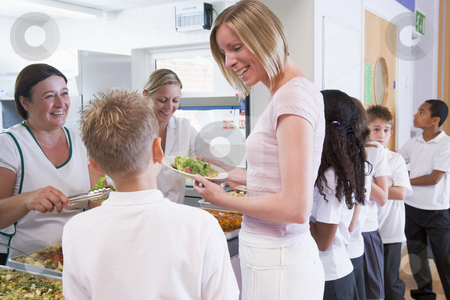 Teacher holding plate of lunch in school cafeteria stock photo,  by Monkey Business Images
