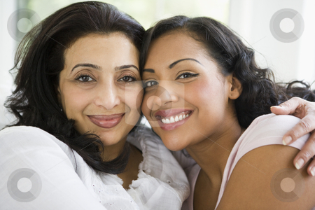 A Middle Eastern woman with her daughter-in-law stock photo,  by Monkey Business Images